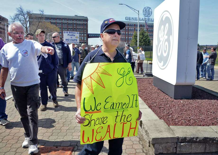 Retiree Johnnie Whitehead of Rotterdam, N.Y., joins former and current GE employees holding a demonstration at GE's main gate Thursday April 21, 2016 in Schenectady, NY. Photo: John Carl D'Annibale / Albany Times Union / 10036288A