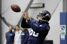 Seattle Seahawks' Jimmy Graham reaches to catch the ball during NFL football practice Thursday, June 15, 2017, in Renton, Wash. (AP Photo/Elaine Thompson)