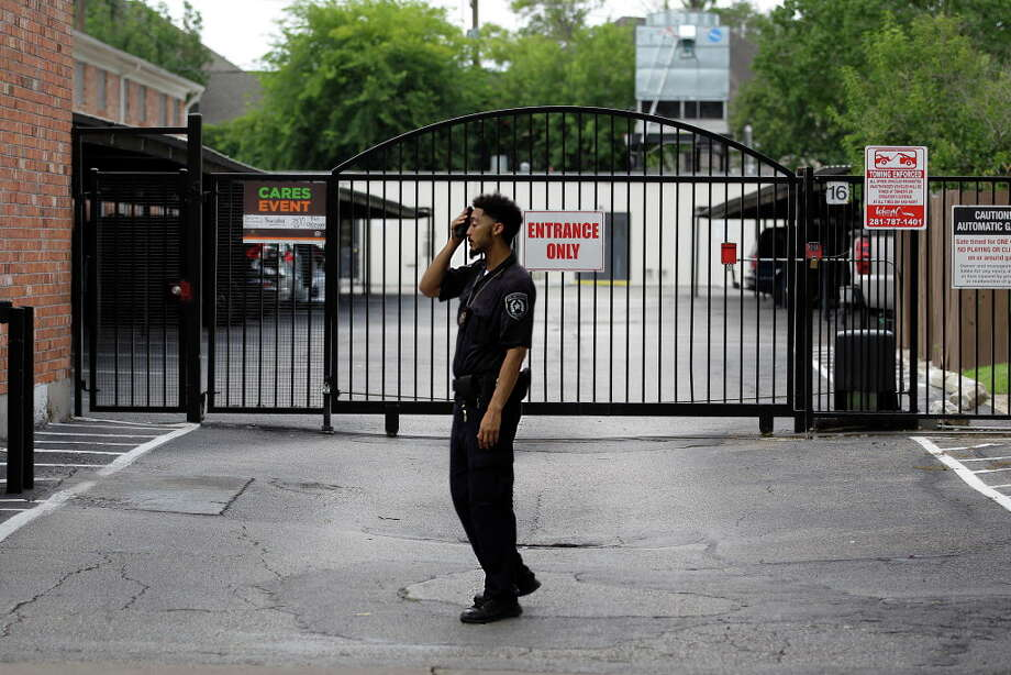 """The presence of security guards was visible Thursday, June 15, 2017, after an infant was shot and killed Wednesday as his father was taking him for a walk outside the Houston Nob Hill Apartments in Houston. A sign on the gate to the left informs residents of a """"Care Event"""" meeting Thursday evening. Photo: Steve Gonzales, Houston Chronicle / © 2017 Houston Chronicle"""