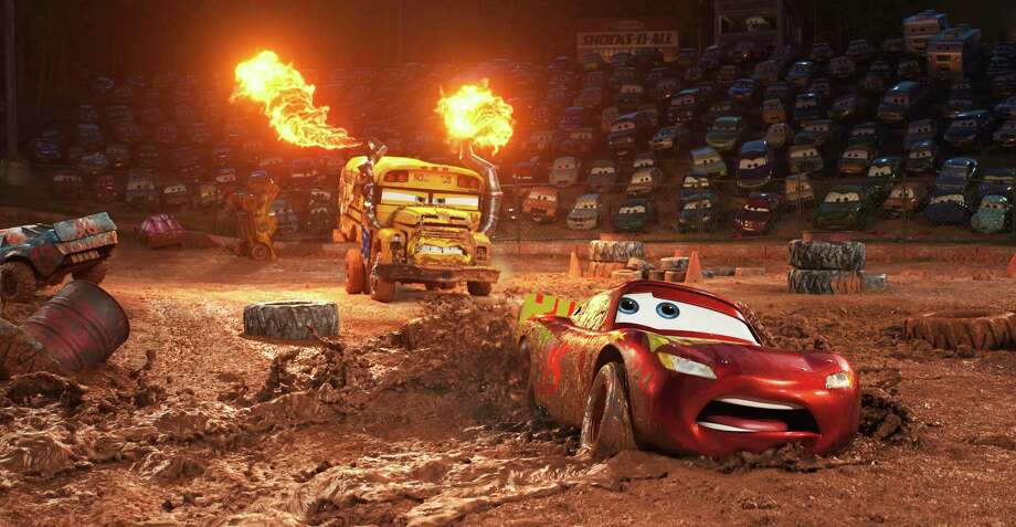 """This image released by Disney shows Lightning McQueen, voiced by Owen Wilson, foreground, in a scene from """"Cars 3."""" (Disney-Pixar via AP) ORG XMIT: NYET601 Photo: Pixar / ©2017 Disney•Pixar. All Rights Reserved."""