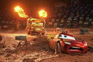 """This image released by Disney shows Lightning McQueen, voiced by Owen Wilson, foreground, in a scene from """"Cars 3."""" (Disney-Pixar via AP) ORG XMIT: NYET601"""