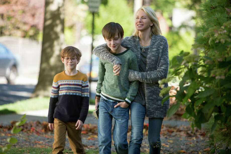 """This image released by Focus Features shows Jacob Tremblay, from left, Jaeden Lieberher and Naomi Watts in a scene from """"The Book of Henry."""" (Alison Cohen Rosa/Focus Features via AP) ORG XMIT: NYET121 Photo: Alison Cohen Rosa / © 2017 Focus Features LLC. All Rights Reserved."""