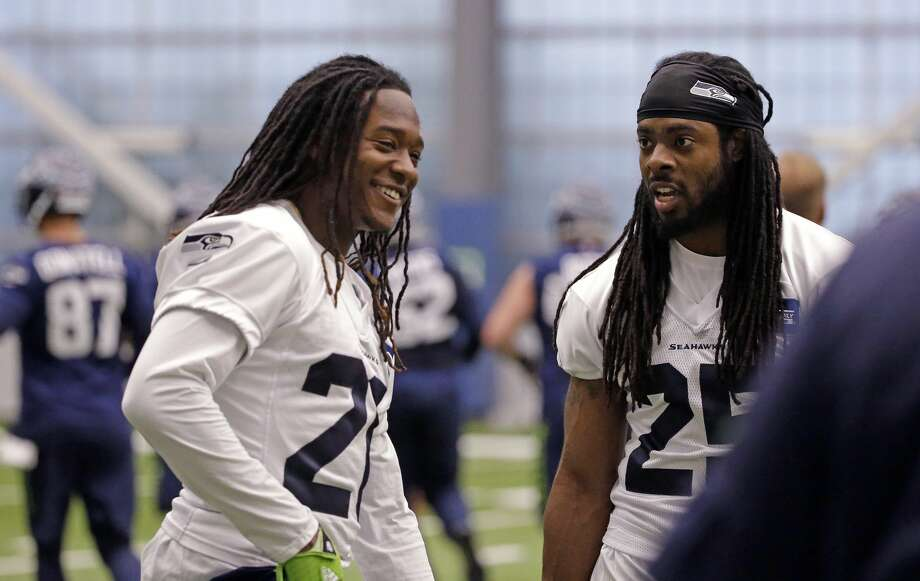 Seattle Seahawks' Shaquill Griffin, left, and Richard Sherman talk between drills during NFL football practice Thursday, June 15, 2017, in Renton. Photo: Elaine Thompson/AP