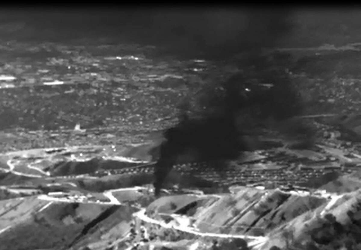 """This infrared image released by the Environmental Defense Fund (EDF) shows methane gas leaking from the Aliso Canyon facility near the Porter Ranch suburb of Los Angeles. California Governor Jerry Brown on January 6, 2016, declared a state of emergency in Porter Ranch as the leak has forced thousands of nearby residents from their homes. Brown said all state agencies would be mobilized to stop the leak that started in October 2015 to protect public health, and to help the local community. == RESTRICTED TO EDITORIAL USE - MANDATORY CREDIT """"AFP PHOTO / ENVIRONMENTAL DEFENSE FUND"""" - NO MARKETING NO ADVERTISING CAMPAIGNS - DISTRIBUTED AS A SERVICE TO CLIENTS =-/AFP/Getty Images"""
