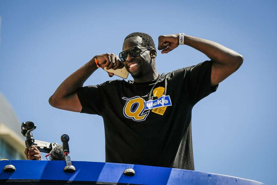 Golden State Warriors'  Draymond Green flexes his muscles during the championship parade in Oakland, Calif., on Thursday, June 15, 2017. Photo: Gabrielle Lurie, The Chronicle