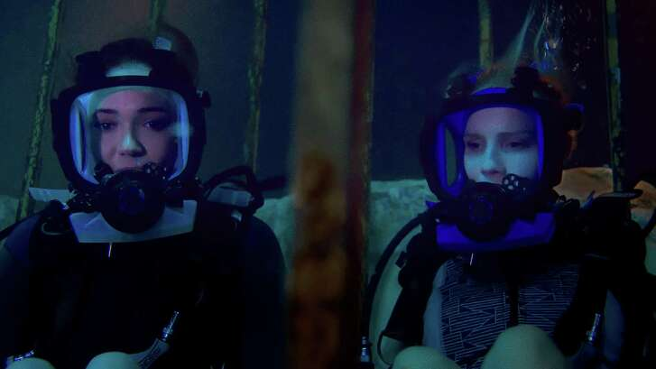 """Sisters Lisa (Mandy Moore, left) and Kate (Claire Holt) get trapped underwater when their shark-cage excursion goes awry in """"47 Meters Down."""""""