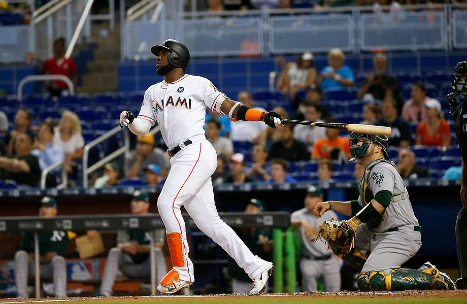Marcell Ozuna put on a power display against the A's this week, including this solo home run that Oakland catcher Stephen Vogt can only watch. Photo: David Santiago, TNS
