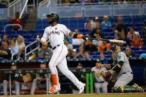 The Miami Marlins' Marcell Ozuna hits a solo home run during the second inning against the Oakland Athletics at Marlins Park on Wednesday, June 14, 2017, in Miami. The Marlins won, 11-6. (David Santiago/El Nuevo Herald/TNS)