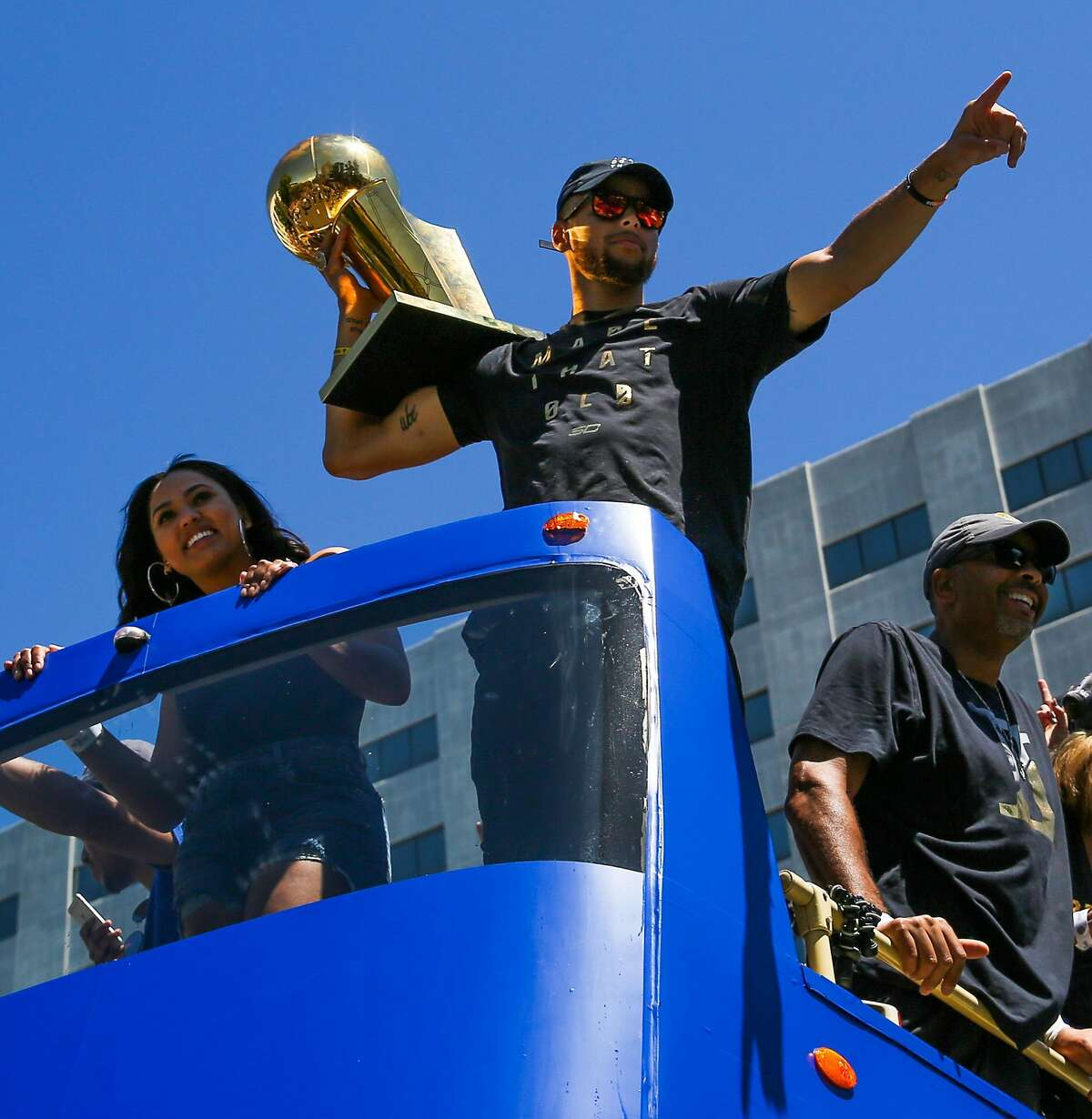 Golden State Warriors' Stephen Curry soaks up the atmosphere during the championship parade in Oakland, Calif., on Thursday, June 15, 2017.