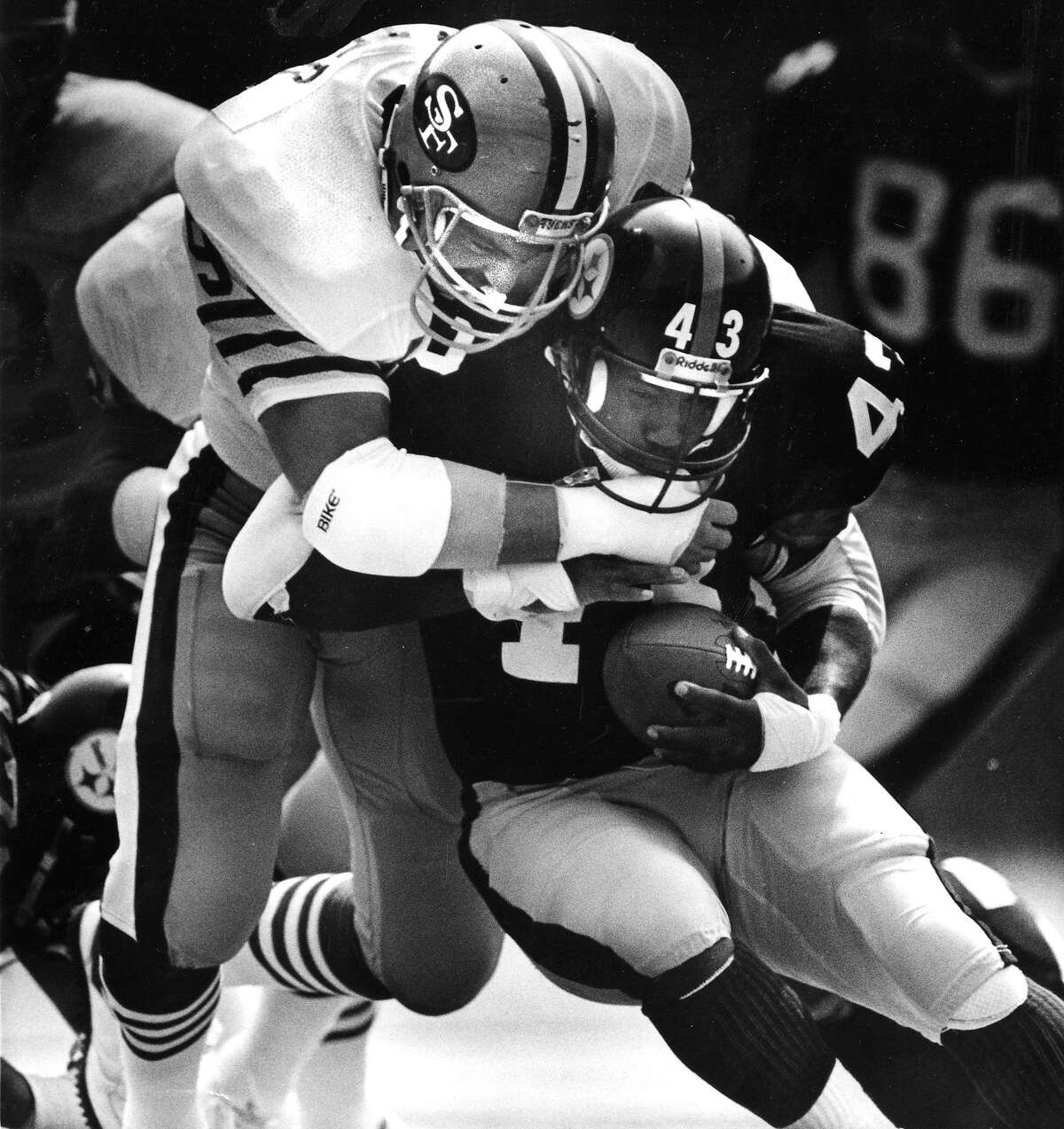 San Francisco 49ers defender Michael Walter tackles Ernest Jackson of the Pittsburgh Steelers September 13, 1987