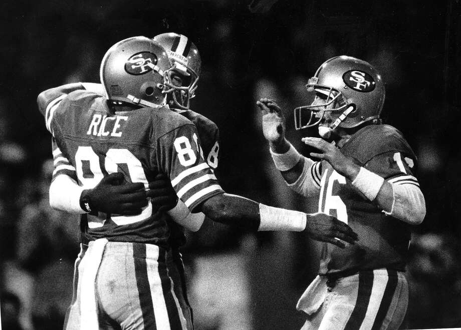 Quarterback Joe Montana congratulates Jerry Rice after a second- quarter touchdown reception on Nov. 29, 1987. Photo: Michael Maloney, San Francisco Chronicle