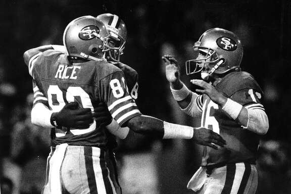 49ers Joe Montana congratulates Jerry Rice after a 2nd quarter touchdown pass, November 29, 1987 Photo ran 11/30/1987, p. D1