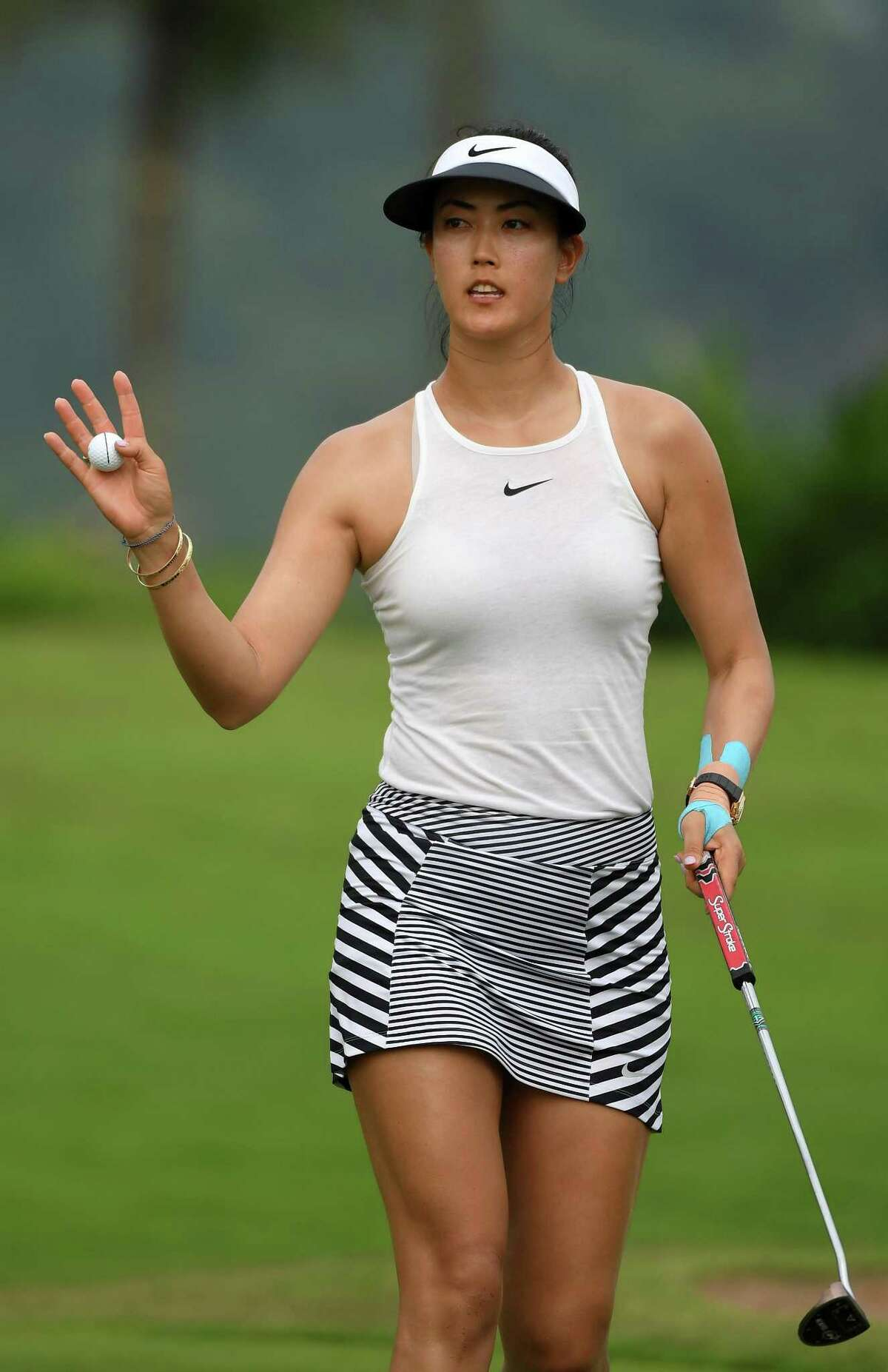 U.S. golfer Michelle Wie on the 18th hole during the recent HSBC Women's Champions in Singapore. She is emerging as a fashion leader in the sport, wearing more athletic gear and less traditional looks. (This Nike skirt is available at the Pro Shop at Sterling Farms Golf Course in Stamford.)