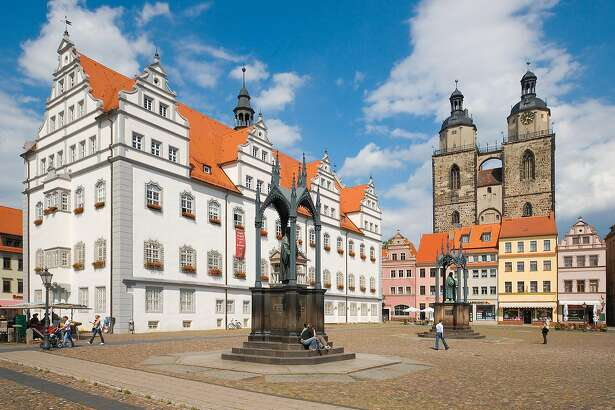The market square, town hall, Melanchthon and Luther monuments and town church in Lutherstadt Wittenberg.