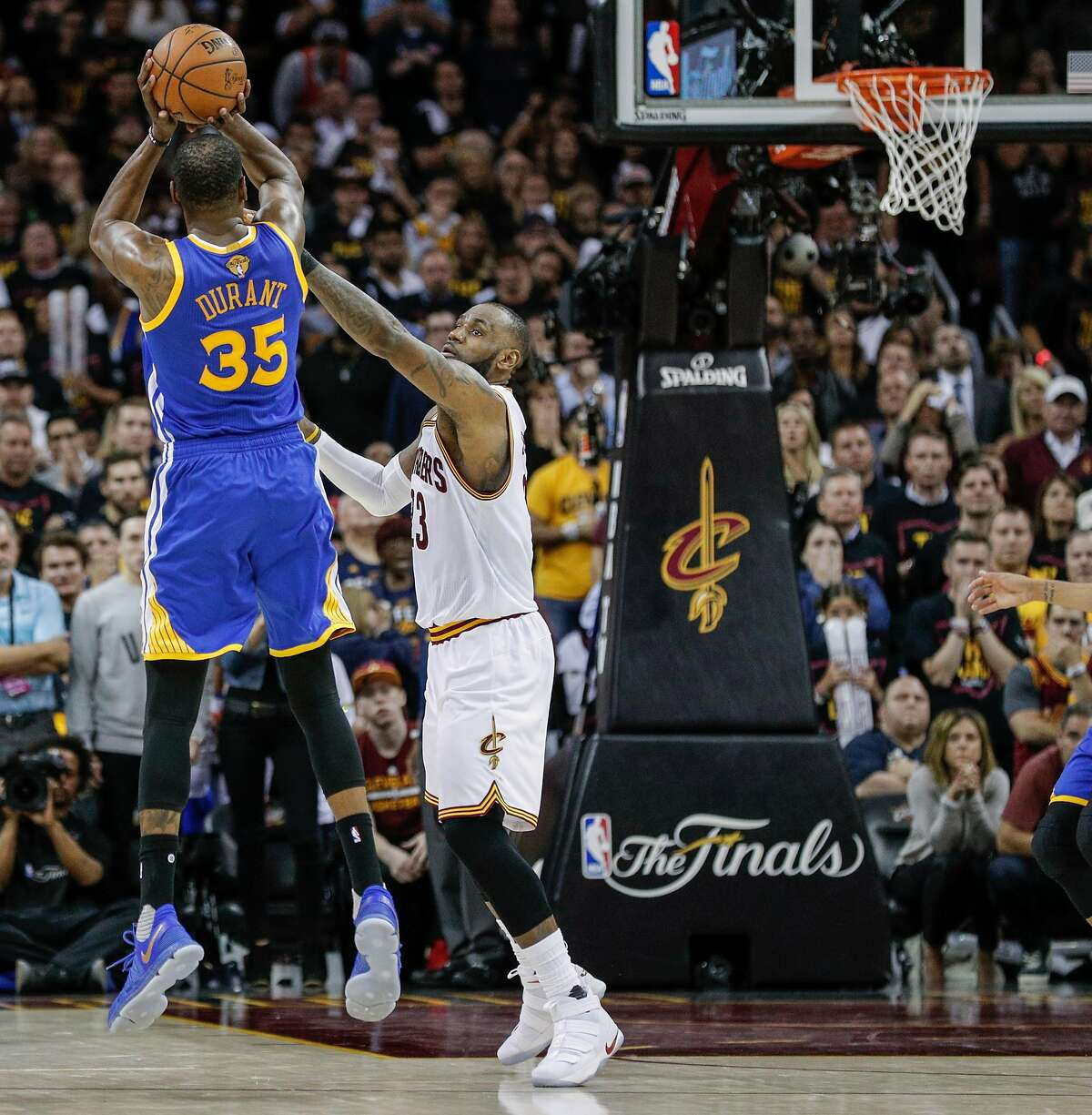 Golden State Warriors' Kevin Durant shoots over Cleveland Cavaliers' LeBron James in the fourth quarter during Game 3 of the 2017 NBA Finals at Quicken Loans Arena on Wednesday, June 7, 2017 in Cleveland, Ohio.