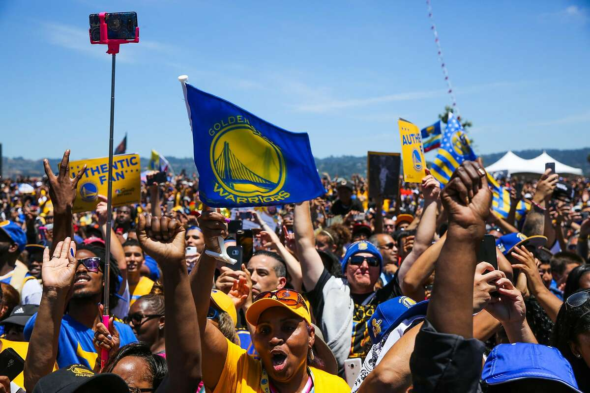 Golden State Warriors' fans cheer during a rally following the Golden State Warriors championship parade in Oakland, Calif., on Thursday, June 15, 2017.