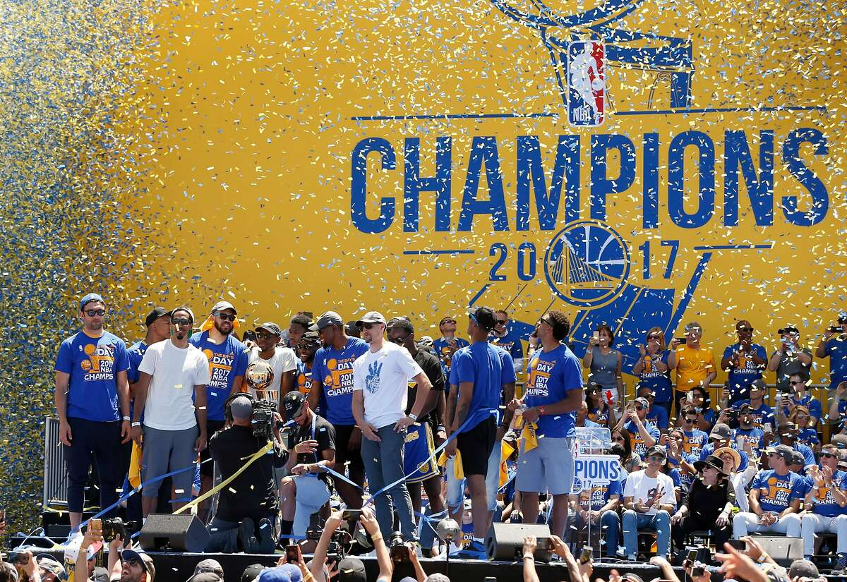 Confetti rains down on the Golden State Warriors players at a victory rally in Oakland, Calif. on Thursday, June 15, 2017.