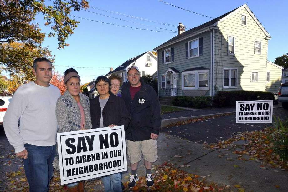 In 2016, Stephen Rich, Emily Ray, Gaby Pareja, Kathleen Connole and Anthony Rinaldi (from left to right) protested outside a house in Stamford that was listed on Airbnb. File photo Photo: Matthew Brown / Hearst Connecticut Media / Stamford Advocate