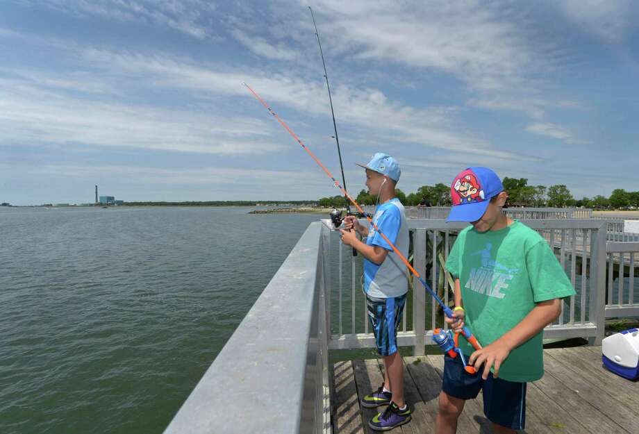 Kostaki Papakosmas and his brother Markos Papakosmas, 11 and 9, fish off the Captain William Clarke Pier Thursday, June 15, 2017 at Calf Pasture Beach in Norwalk, Conn.