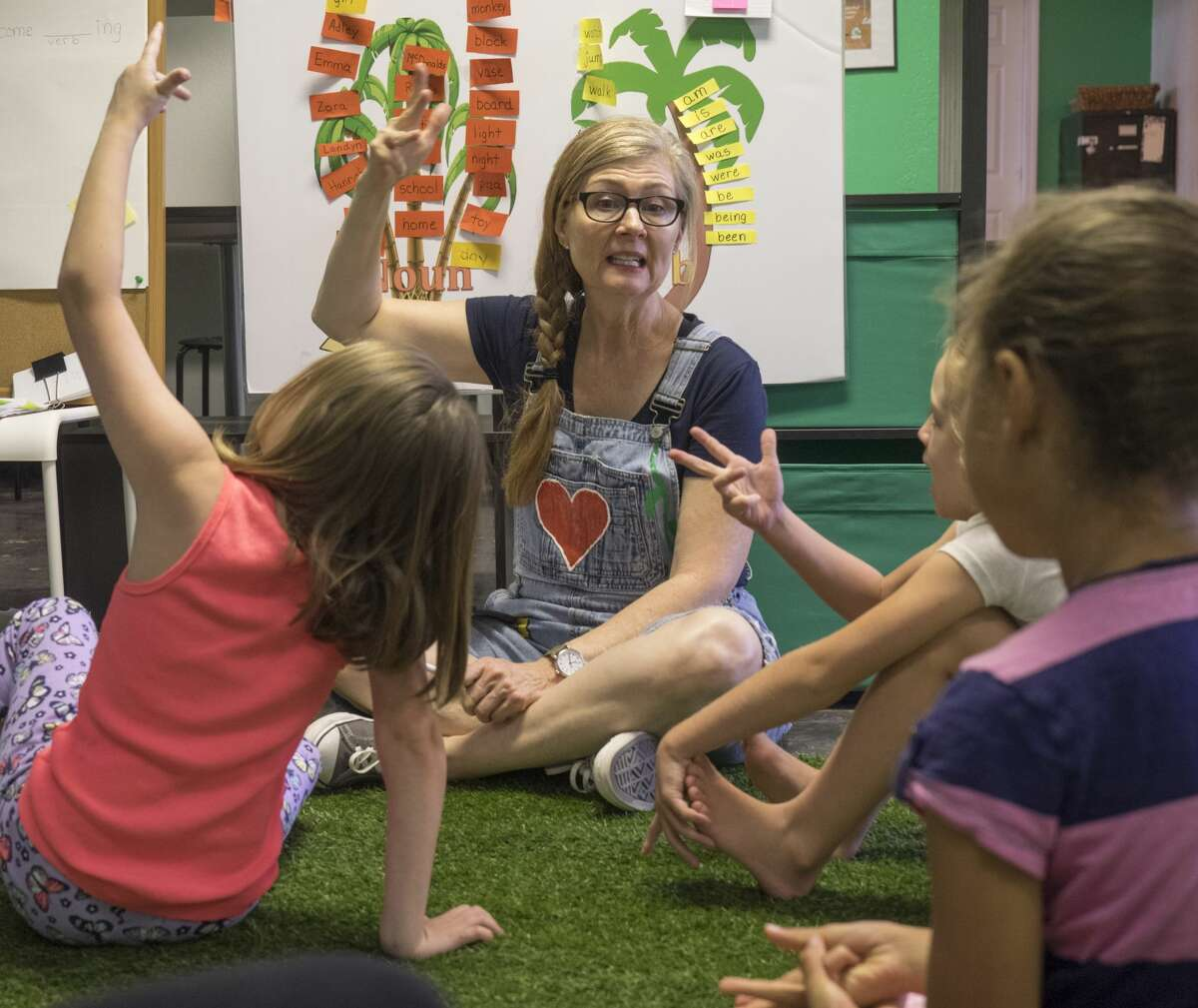 Nessy instructor Pam Hinton wotks with students 6/13/17 on nouns, verbs and word sounds at Nessy Reading Center. Tim Fischer/Reporter-Telegram