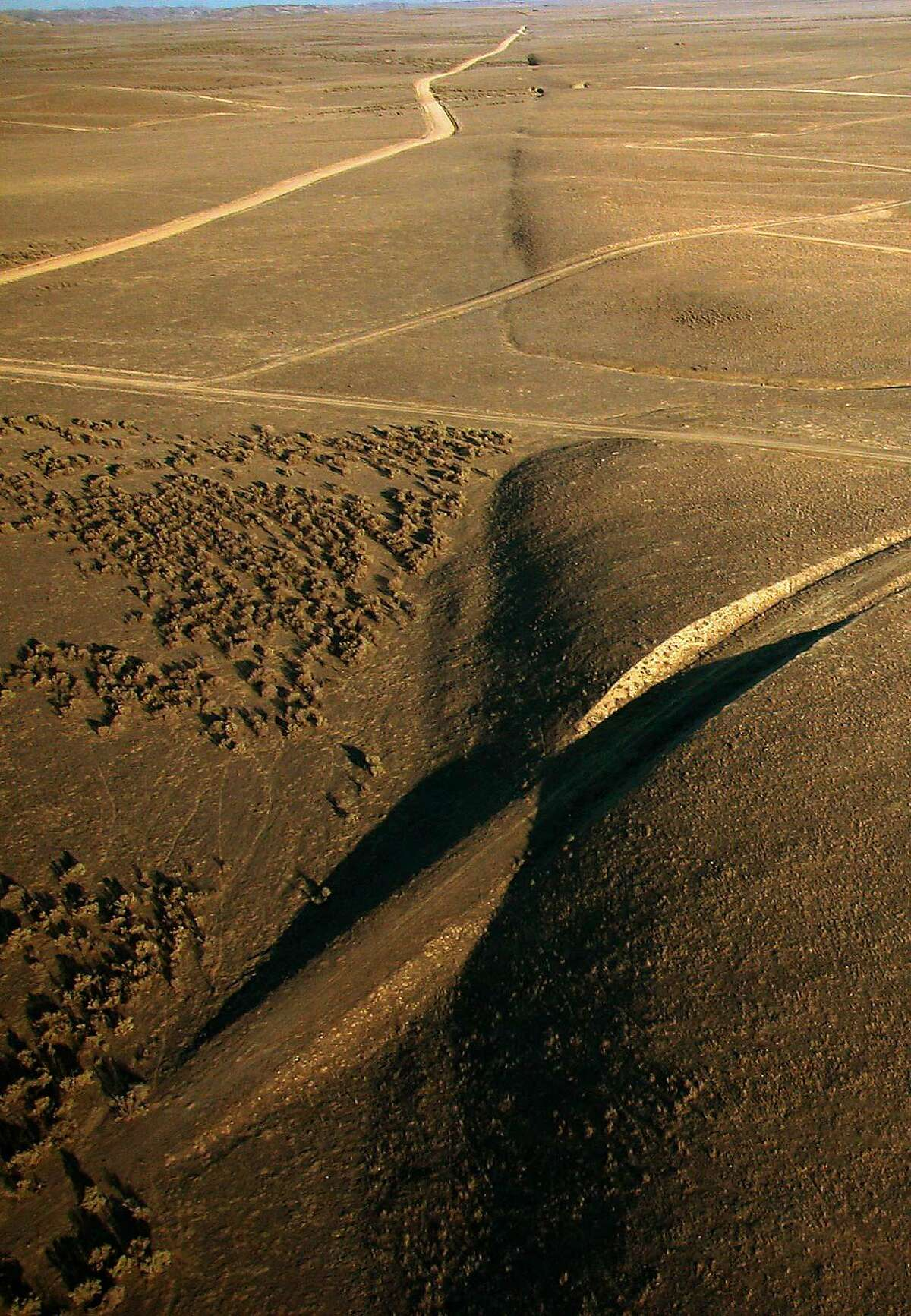 This recent aerial photo provided by United States Geological Survey, shows a view looking southeast along the surface trace of the San Andreas fault in the Carrizo Plain area of California. Elkhorn Rd. meets the fault near the top of the photo. The magnitute-7.9 Fort Tejon earthquake in 1857 caused a horizontal shift of about 30 feet near this stretch of the fault. The 150th anniversary Fort Tejon earthquake is Tuesday, Jan. 9, 2007, but, it's the California earthquake hardly anyone has heard of _ strong enough to rip 225 miles of the San Andreas Fault and make rivers run backward, but leaving nothing like the cultural scar inflicted by the San Francisco Quake of 1906. (AP Photo/U.S. Geological Survey, Scott Haefner)