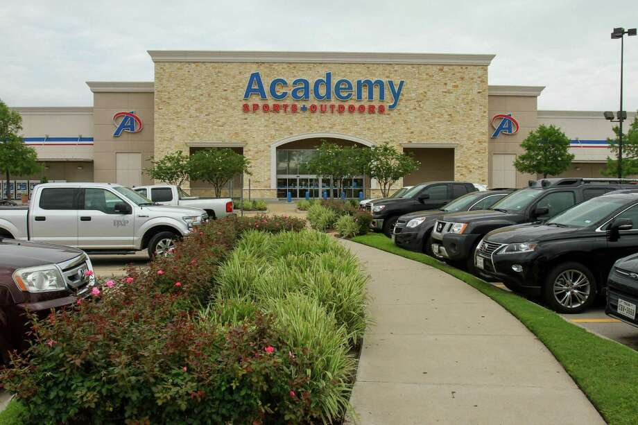 The Academy Sports & Outdoors store at 9734 Katy Freeway. Academy is offering a buy-one, get-one-free deal on handguns as part of its Father's Day sale. Photo: Gary Fountain /Gary Fountain /For The Chronicle / Freelance