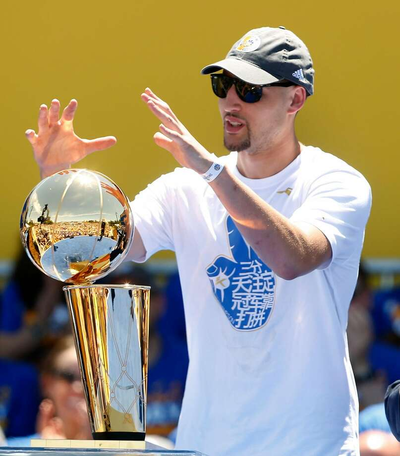 Klay Thompson reaches out to touch the Larry O'Brien trophy at the Golden State Warriors victory rally in Oakland, Calif. on Thursday, June 15, 2017. Photo: Paul Chinn, The Chronicle