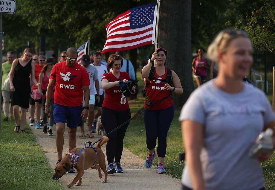 A group of veterans participate in a run/walk event to show solidarity after a shooting at the Eugene Simpson Stadium Park June 14, 2017 in Alexandria, Virginia. U.S. House Majority Whip Rep. Steve Scalise (R-LA) and multiple congressional aides were shot by a gunman during a Republican baseball practice. Photo: Alex Wong, Getty Images