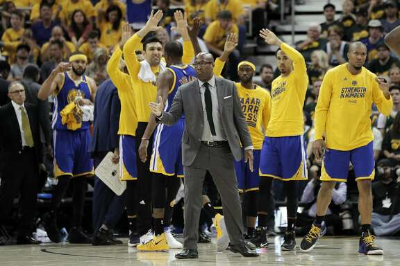 The Warriors bench celebrates in the closing seconds of the second half as the Golden State Warriors played the Utah Jazz at Vivint Smart Home Arena in Salt Lake City, Utah, on Saturday, May 6, 2017, in Game 3 of the 2017 Western Conference Semifinals.