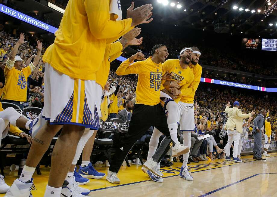 Golden State Warriors' Patrick McCaw, center, James Michael McAdoo, and JaVale McGee celebrate on the bench in the fourth quarter during Game 1 of the 2017 NBA Playoffs Western Conference Finals at Oracle Arena on Sunday, May 14, 2017 in Oakland, Calif. Photo: Carlos Avila Gonzalez, The Chronicle