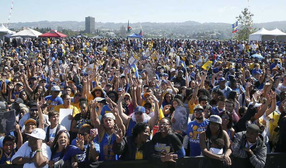 Thousands of fans gather near the Henry Kaiser Convention Center for the start of the Golden State Warriors victory parade and rally in Oakland on June 15. Photo: Paul Chinn, The Chronicle