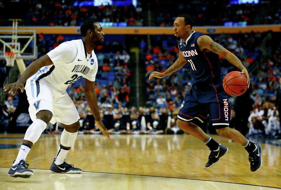 UConn's Ryan Boatright dribbles while defended by Villanova's JayVaughn Pinkston during the third round of the 2014 NCAA Men's Basketball Tournament at the First Niagara Center on March 22, 2014 in Buffalo, New York. The former Big East rivals will begin a 3-game series in 2018. Photo: Jared Wickerham / Getty Images / 2014 Getty Images