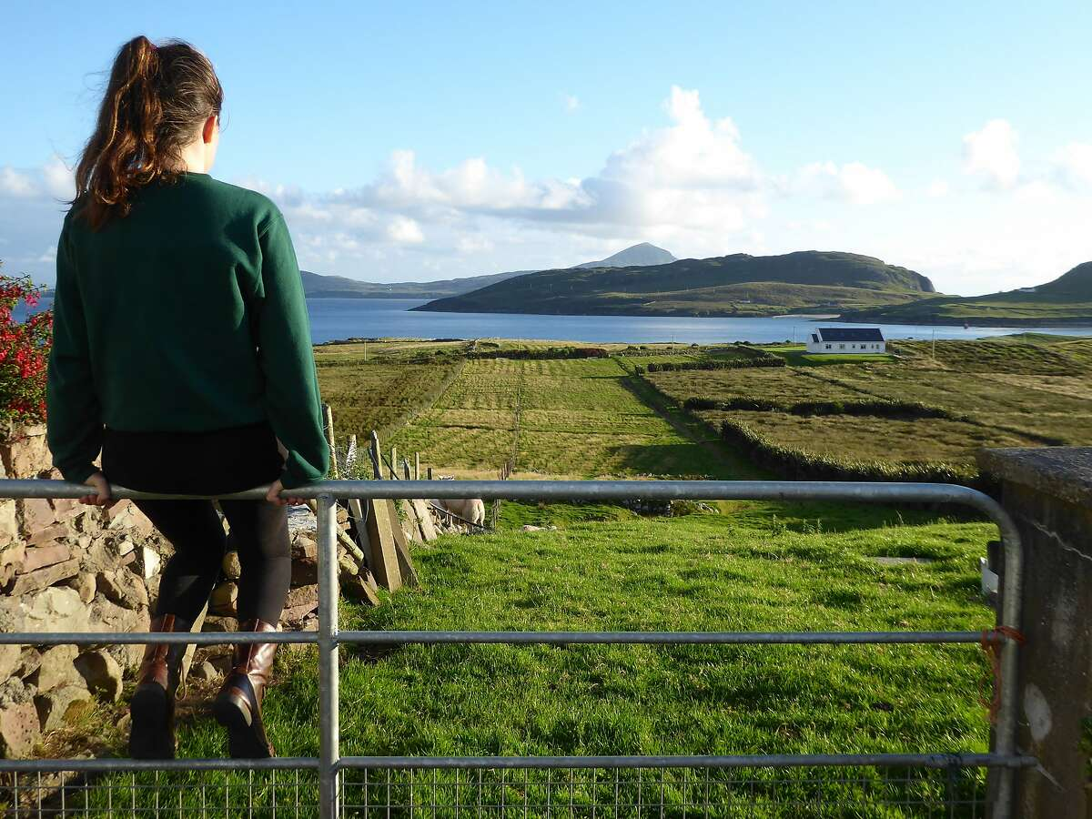 A teen takes in the view of the sheep pasture and Clew Bay, the back yard of John and Mary Fallon�s Holiday Home Cottage in Currane.