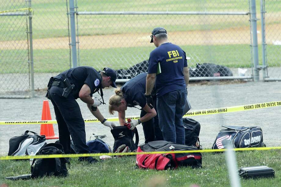 ALEXANDRIA, VA - JUNE 14:  Investigators search the bags that have been left behind at the Eugene Simpson Stadium Park where a shooting had happened June 14, 2017 in Alexandria, Virginia. U.S. House Majority Whip Rep. Steve Scalise (R-LA) and multiple congressional aides were shot by a gunman during a Republican baseball practice.  (Photo by Alex Wong/Getty Images) Photo: Alex Wong, Staff / 2017 Getty Images