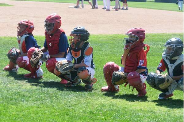 Catchers get into their squats and prepare for action during the Bulldog Baseball Camp last year. This year's camp will be next week from Monday through Wednesday.