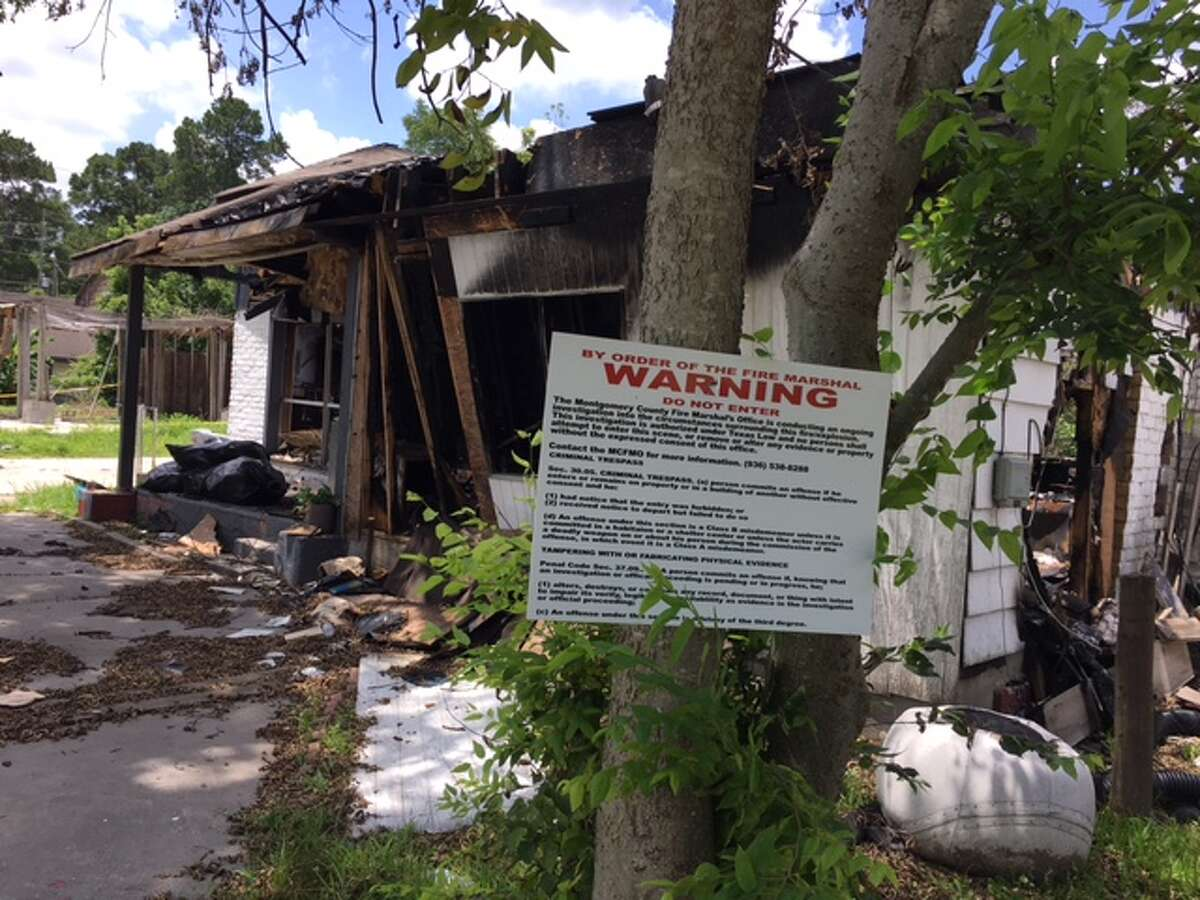 A sign warns that an investigation is underway at the site of a fire that killed three children in Tamina in May.