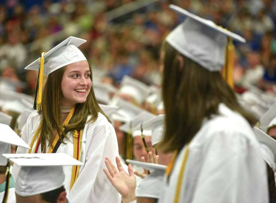 Sara Capella looks for someone in the crowd as she is introduced as one of the top students in the class of 2017 during the Joel Barlow High School, Class of 2017, Fifty-Seventh Annual Commencement Ceremony, on Thursday night, June 15, 2017, at the William A. O'Neill Center, Western Connecticut State University, Danbury, Conn. Photo: H John Voorhees III, Hearst Connecticut Media / The News-Times