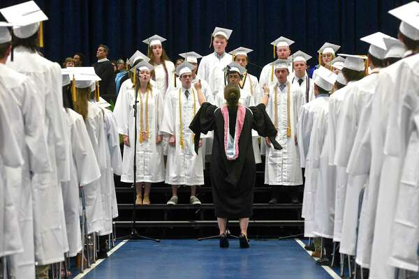 Senior members of the Joel Barlow Chorale perform the Star-Spangled Banner during the Joel Barlow High School, Class of 2017, Fifty-Seventh Annual Commencement Ceremony, on Thursday night, June 15, 2017, at the William A. O'Neill Center, Western Connecticut State University, Danbury, Conn.