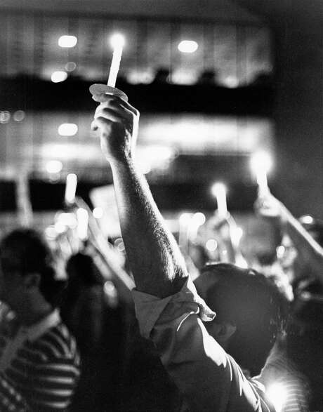 In this June 16, 1977 photo, about 3,000 people, including members and supporters of Houston's gay community, lit candles in the Houston Public Library plaza to complete their march to protest singer Anita Bryant's anti-homosexual stand. (File Photo). Photo: Othell O. Owensby Jr., HC Staff / Houston Chronicle