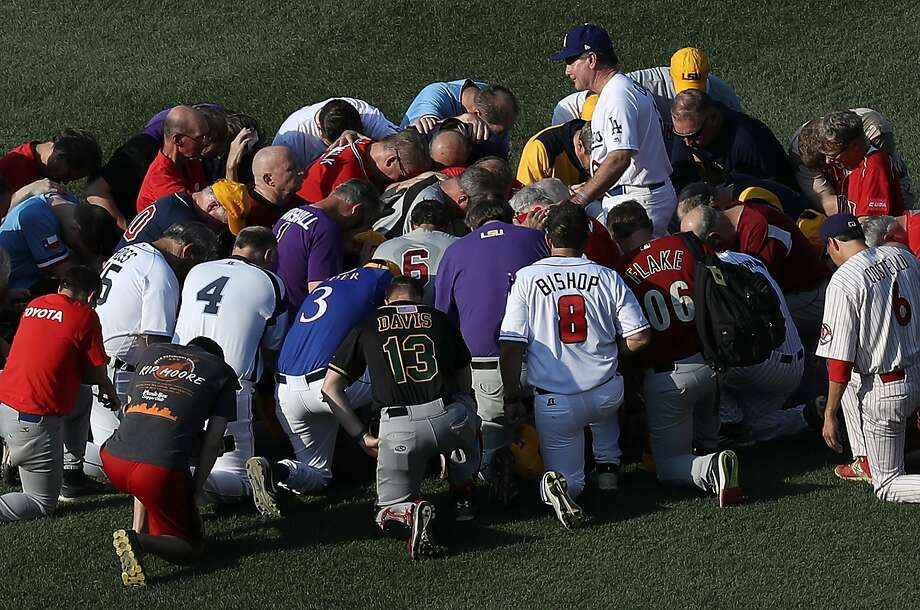 WASHINGTON, DC - JUNE 15:  Members of the Republican congressional baseball team gather for a prayer before the start of the Congressional Baseball Game at Nationals Park on June 15, 2017 in Washington, DC. U.S. House Majority Whip Rep. Steve Scalise (R-LA) is in critical condition following a shooting yesterday during a Republican congressional baseball team practice.  (Photo by Win McNamee/Getty Images) Photo: Win McNamee, Getty Images
