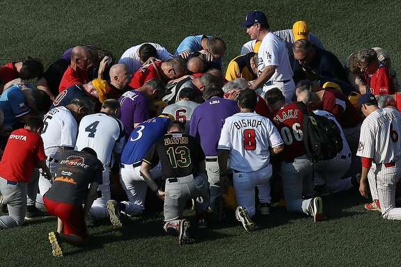 WASHINGTON, DC - JUNE 15:  Members of the Republican congressional baseball team gather for a prayer before the start of the Congressional Baseball Game at Nationals Park on June 15, 2017 in Washington, DC. U.S. House Majority Whip Rep. Steve Scalise (R-LA) is in critical condition following a shooting yesterday during a Republican congressional baseball team practice.  (Photo by Win McNamee/Getty Images)