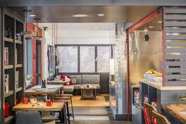 The multi-use lobby of the new Mountain Modern Motel in Jackson, Wyo., offers cozy seating with breakfast and lunch options by day and lounge drinks by night.