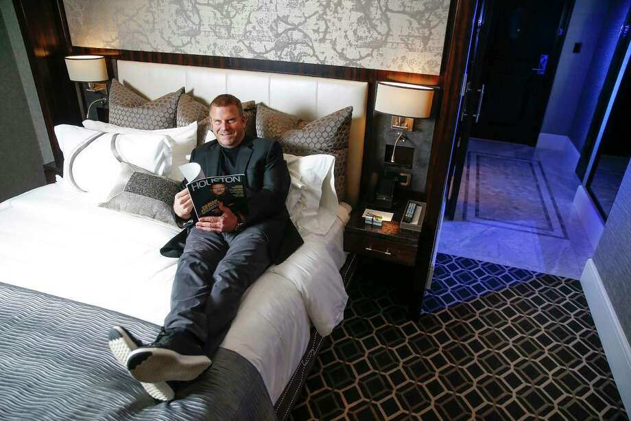 Chairman, CEO and owner of Landry's, Inc. Tilman Fertitta sits on the bed in a model room of his new Post Oak hotel Friday, June 2, 2017 in Houston. ( Michael Ciaglo / Houston Chronicle ) Photo: Michael Ciaglo, Staff / Michael Ciaglo