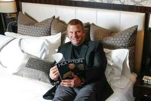 Chairman, CEO and owner of Landry's, Inc. Tilman Fertitta sits on the bed in a model room of his new Post Oak hotel Friday, June 2, 2017 in Houston. ( Michael Ciaglo / Houston Chronicle )
