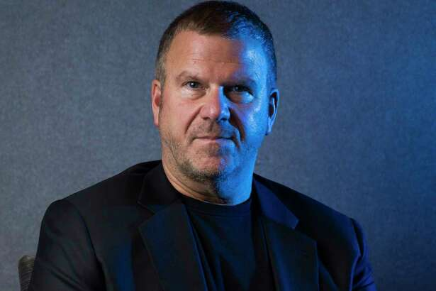 Chairman, CEO and owner of Landry's, Inc. Tilman Fertitta sits in a model