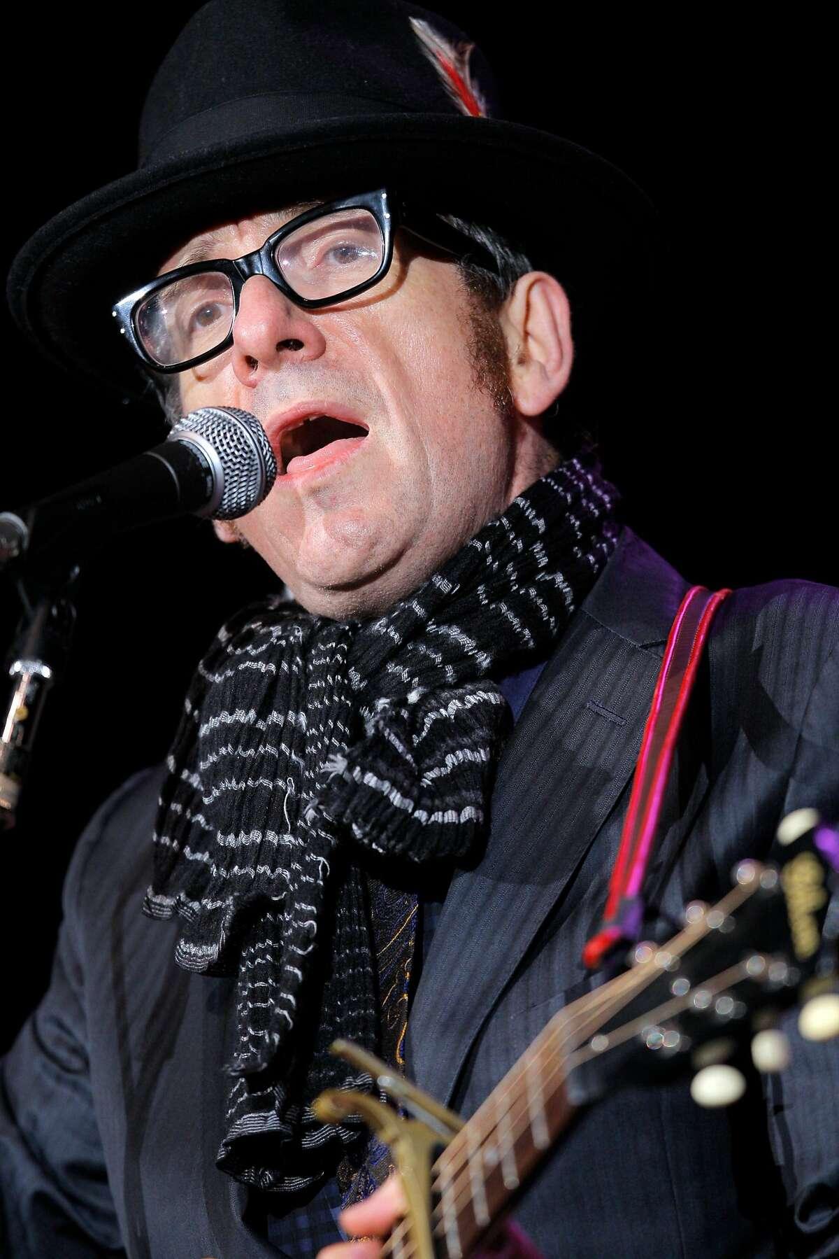 Elvis Costello performs during Neil Young's annual Bridge School Benefit concert at Shoreline Amphitheatre Saturday, October 23, 2010, Mountain View, Calif.