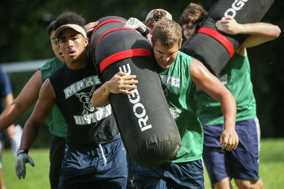 College Park linemen participate in the Worm Carry event during the Oak Ridge War Zone Lineman Challenge on Saturday, June 18, 2016, at Oak Ridge High School. (Michael Minasi / Chronicle) Photo: Michael Minasi, Staff / © 2017 Houston Chronicle