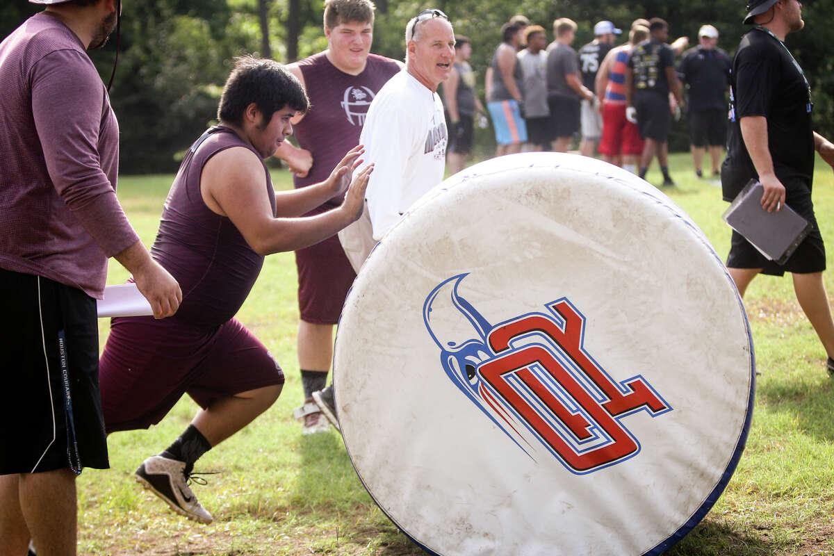 Magnolia linemen participate in the PowerDrive Push event during the Oak Ridge War Zone Lineman Challenge on Saturday, June 18, 2016, at Oak Ridge High School. (Michael Minasi / Chronicle)
