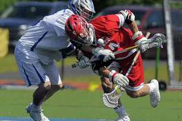 Darien's Tanner Strub and Greenwich's Bailey Savio faceoff in a CIAC boys lacrosse quarterfinal game at Darien High School in Darien on June 3. Savio won 77 percent of faceoffs and was rewarded by being named to the U.S. Lacrosse Connecticut All-America Lacrosse Team. A faceoff specialist/midfielder, Savio also earned First Team All-State (Class L) honors and was an All-FCIAC First-Team selection.