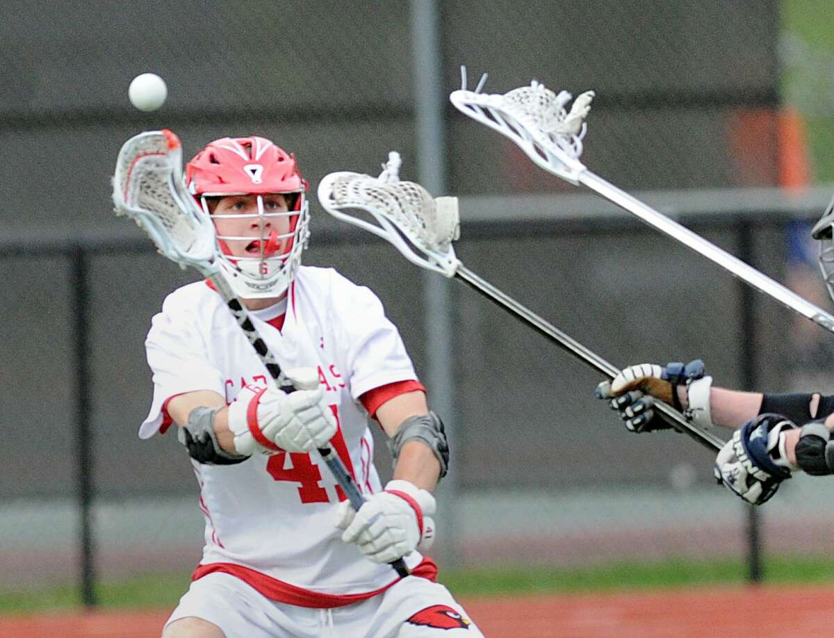 Jack O'Connor of Greenwich passes against Brien McMahon High School on May 9. O'Connor, one of the Cardinals' senior captains earned Second Team All-State honors and was an All-FCIAC First-Team selection. O'Connor recorded 29 goals on the season for Greenwich.